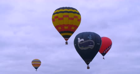 from air : Colorful hot air baloons flying at a festival Stock Footage