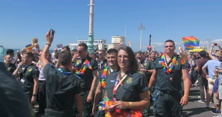 gurur : Health workers at Brighton gay pride parade Stok Video