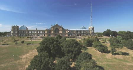 alexandra park : Aerial approaching view of Alexandra Palace in London Stock Footage