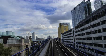 docklands : Timelapse of the Docklands in London in motion from a fast moving train, POV hyperlapse Stock Footage
