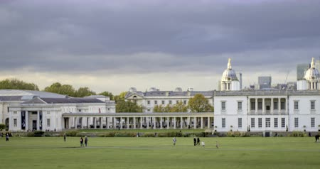 greenwich : Time lapse panning view of the Old Royal Naval College and the Queens house in Greenwich, London, with the financial district of the Docklands in the background