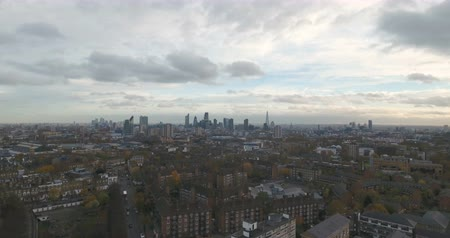 kasaba : Aerial push out view of a typical village in North London with the skyline of London in the background
