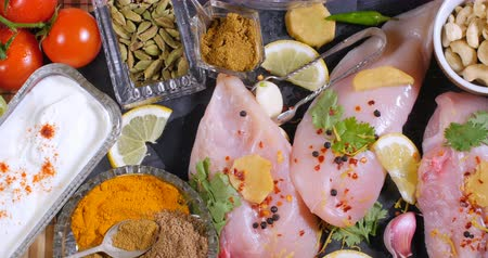tikka : Dolly top down close up view of ingredients and indian spices for chicken tikka masala Stock Footage