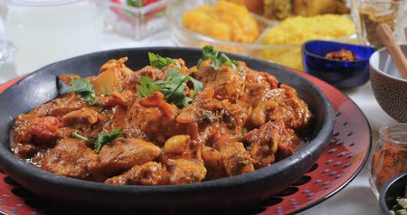 tikka : Sprinkling fresh coriander over a delicious chicken tikka masala with Indian spices