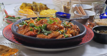 tikka masala : Dolly panning view of a delicious chicken tikka masala with Indian spices