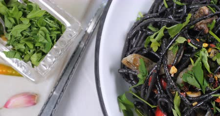 kalmar : Dolly top down view of delicious black pasta with squids (cuttlefish) and ink