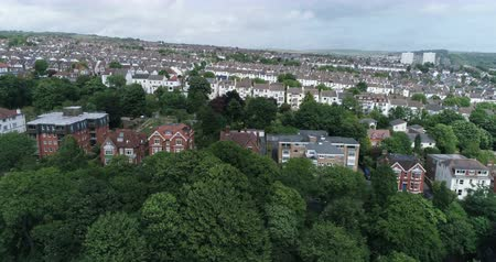 kasaba : Aerial dolly view of the West part of the town of Brighton and the sloping South Downs (England) Stok Video