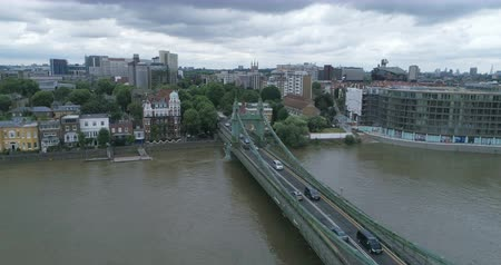the suspension bridge : Aerial descending view of Hammersmith bridge and the river Thames in West London