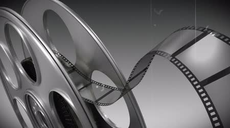 taŚma filmowa : Digitally generated of film reel against black and white background