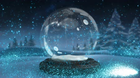 ünnepies : Sparkling light spirally moving around the snow globe on winter landscape