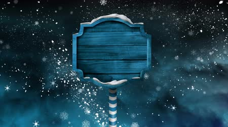 poste de sinalização : Digital composite of Wooden sign with Winter snow night sky