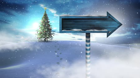 poste de sinalização : Digital composite of Christmas tree and arrow sign in Winter landscape