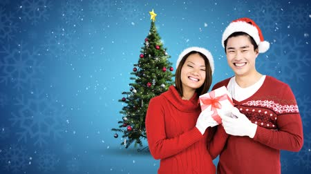 fondness : Digital composite of Christmas Winter couple with Christmas tree and gift