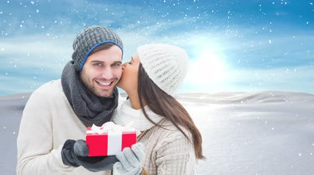 yanak : Digital composite of Winter couple with Winter snow landscape and gift