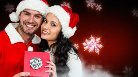 Навидад : Digital composite of Christmas Winter couple with snowflakes and gift