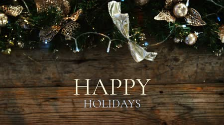 jedle : Digital composite of Happy holidays text and Christmas decoration