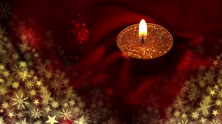 extinguishing : Digital composite of Christmas candle burning with snowflakes Stock Footage
