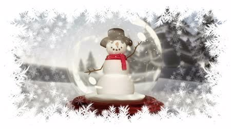 snow globe : Digital composite of Christmas snowflake border with snowman in snow globe Stock Footage