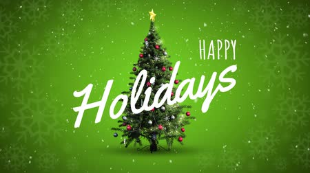 bombki : Digital composite of Happy holidays text and Christmas tree Wideo