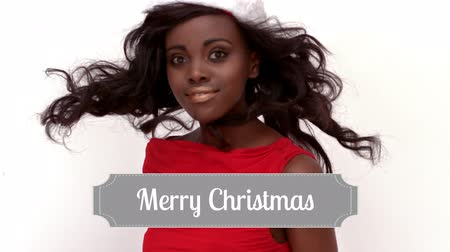 Санта : Digital composite of Merry Christmas text and Santa dressed beautiful woman