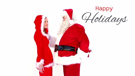 holidays : Digital composite of Happy Holidays text and Santa giving gift to woman Stock Footage