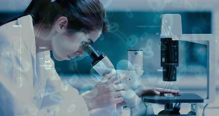 vérplazma : Digital composite of Science Composition Woman looking into a microscope combined with animated microorganisms Stock mozgókép