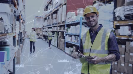 hard hat : Digital composite of Warehouse Composition of Man in the warehouse combined with animation of connected things