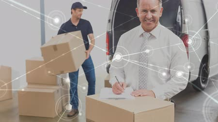 доставки : Digital composite of Warehouse Composition of Two men packing boxes into a van combined with animation of connection