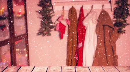ganchos para ropa : Digital composite of Wardrobe with winter coats combined with falling snow