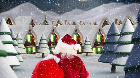 father christmas : Digital composite of Santa clause in front of decorated houses combined with falling snow