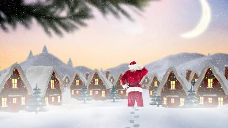 ślady stóp : Digital composite of Santa clause in front of decorated houses combined with falling snow