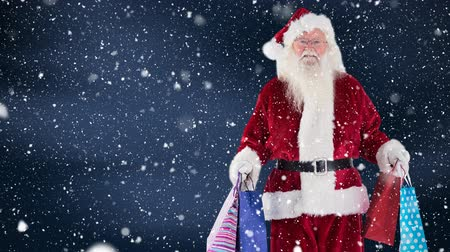 прогноз : Digital composite of Santa clause with shopping bags combined with falling snow
