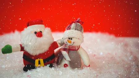 sahte : Digital composite of Falling snow with Christmas Santa and snowman decoration