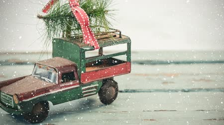 縛ら : Digital composite of Model car with a christmas tree on its roof combined with falling snow