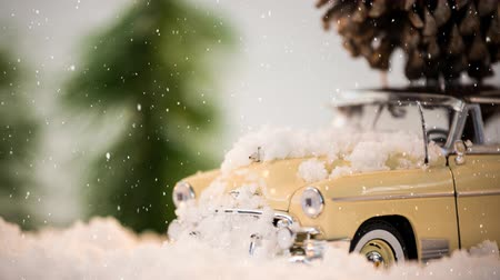 sahte : Digital composite of Model car with a fir cone on its roof on a carpet combined with falling snow