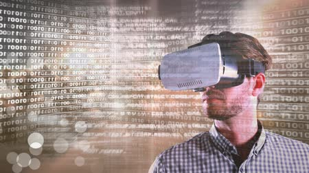iluminado pelo sol : Digital composite of Code and technology interface with virtual reality headset on man