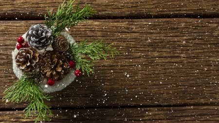 martwa natura : Digital composite of Falling snow with Christmas decoration on wood Wideo