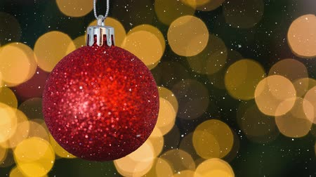 glittery : Digital composite of Falling snow and Christmas bauble decoration Stock Footage