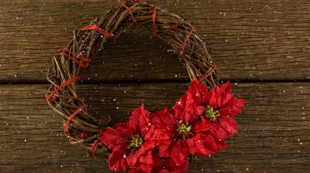 kırılganlık : Digital composite of Falling snow with Christmas wreath decoration on wood Stok Video
