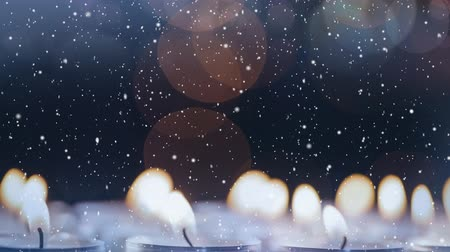 chrześcijaństwo : Digital composite of Candles combined with falling snow