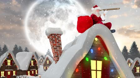 távcső : Digital composite of Santa clause on a roof of a decorated house in winter scenery combined with falling snow