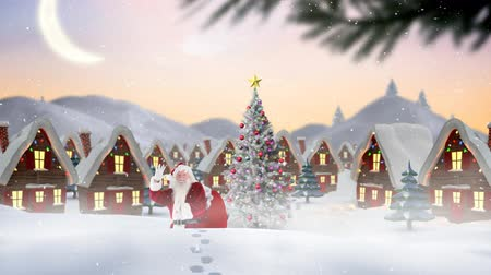 pegada : Digital composite of Santa clause in front of decorated houses combined with falling snow