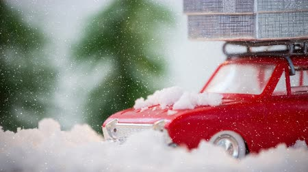 wrapped up : Digital composite of Red model car in winter scenery combined with falling snow