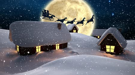 sob : Digital composite of Video composition with snow over night winter scenery with  santa on sleigh