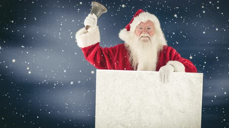 hava durumu : Digital composite of Santa clause holding a sign and a bell combined with falling snow Stok Video
