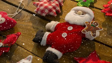 checked pattern : Digital composite of Falling snow with Christmas Santa decoration