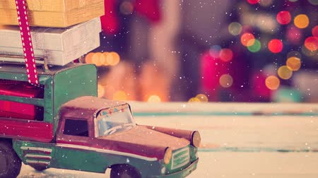 fireplace : Digital composite of Model car with presents on its roof combined with falling snow
