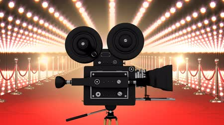 photography themes : Digital composite of Movie film camera with flashing lights and red carpet