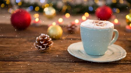 ivászat : Digital composite of Falling snow with Christmas coffee decoration Stock mozgókép