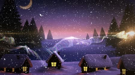 image house : Digital composite of Video composition with falling snow  over village winter scene at night